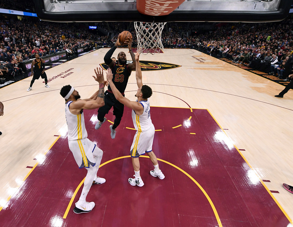 . Cleveland Cavaliers\' LeBron James (23) shoots against Golden State Warriors\' JaVale McGee, left, and Klay Thompson during the first half of Game 3 of basketball\'s NBA Finals, Wednesday, June 6, 2018, in Cleveland. (Kyle Terada/Pool Photo via AP)