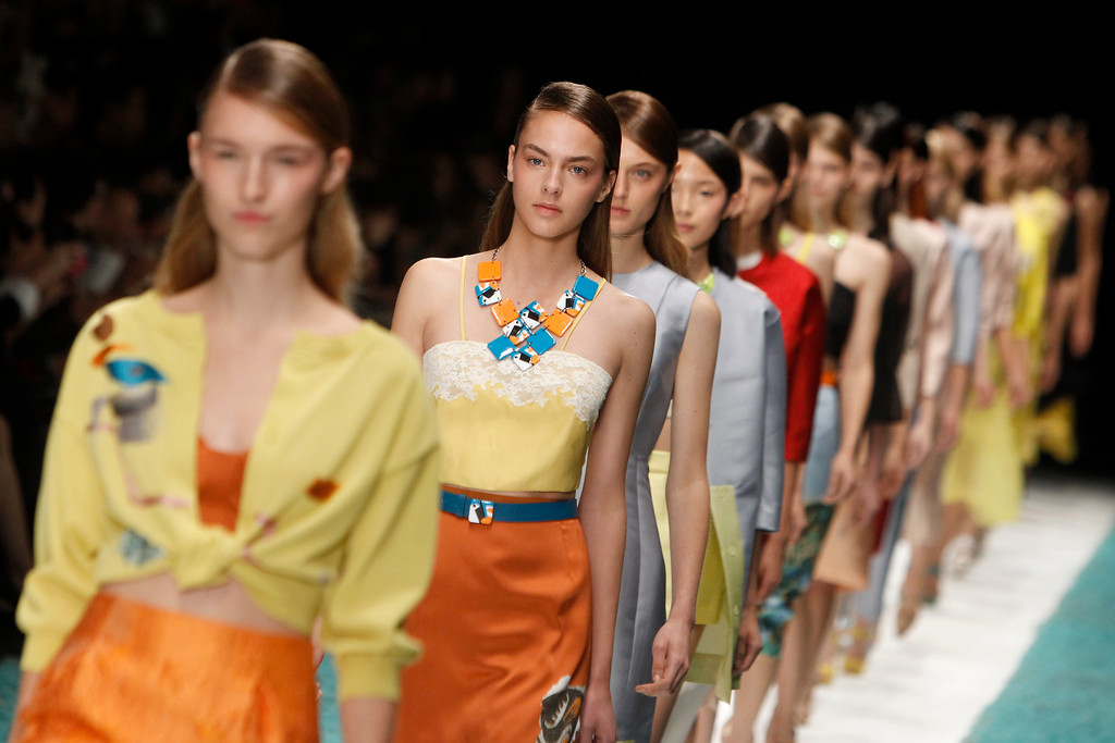 . Models present creations as part of Shiatzy Chen\'s ready-to-wear Spring/Summer 2014 fashion collection, Tuesday, Oct. 1, 2013 in Paris. (AP Photo/Thibault Camus)