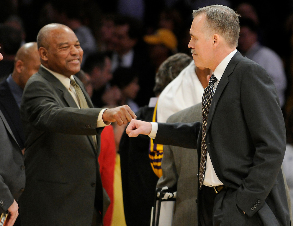 . Interum head coach Bernie Bickerstaff congratulates new Head Coach Mike D\'Antoni on his first win. The Lakers defeated the Brooklyn Nets 95-90 in a game played at Staples Center in Los Angeles, CA. The game was new coach Mike D\'Antoni\'s first victory as a Laker. 11/20/12 (photos by John McCoy/Staff Photographer)