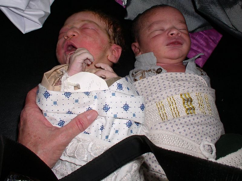 """My Afghani Babies - I wrapped the newborn on the left within 15 minutes of arrival. Parents bring in the """"clothes"""", each is then bundled and wrapped with a belt-type cotton item."""