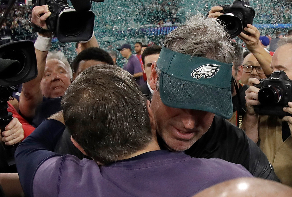 . Philadelphia Eagles head coach Doug Pederson, right, hugs New England Patriots head coach Bill Belichick after the NFL Super Bowl 52 football game against the New England Patriots, Sunday, Feb. 4, 2018, in Minneapolis. The Eagles won 41-33. (AP Photo/Mark Humphrey)