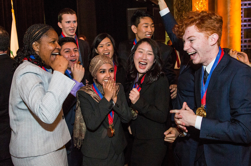 . Members and their Coach Stephanie Franklin (Left) of the 1st Place team of the 35th annual California Academic Decathlon from El Camino Real Charter High School celebrate their win at the 35th annual California Academic Decathlon, in Sacramento, California, U.S., on Sunday, March 23 2014. Ken James/LA Daily News