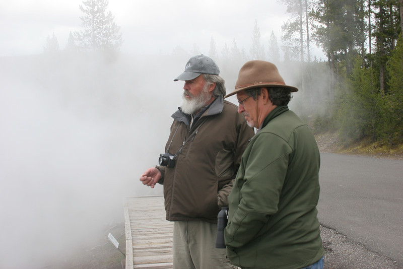 Ed and Mike standing in the steam of a hot springs