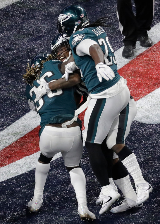 . Philadelphia Eagles running back Corey Clement, middle, celebrates after scoring against the New England Patriots during the second half of the NFL Super Bowl 52 football game Sunday, Feb. 4, 2018, in Minneapolis. (AP Photo/Eric Gay)