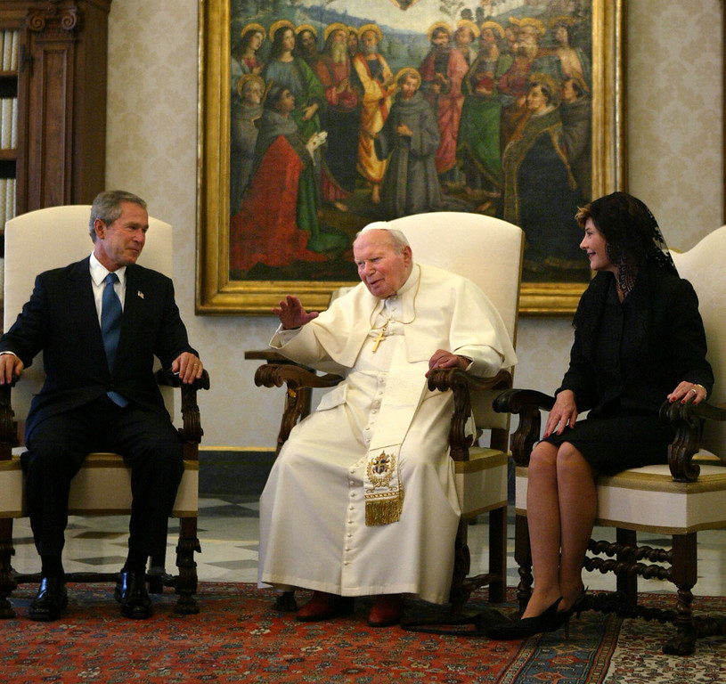 . President Bush and first lady Laura Bush meet with Pope John Paul II in his private library at the Vatican Friday, June 4, 2004. (AP Photo/Charles Dharapak)