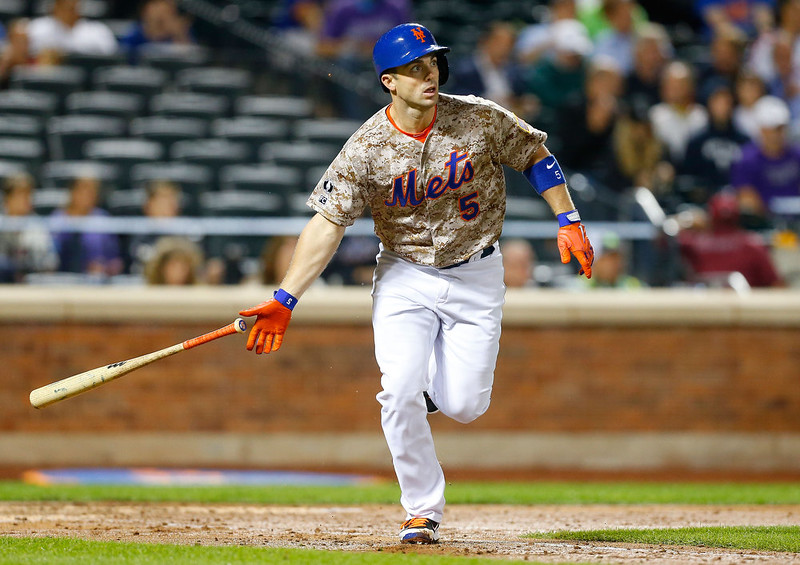 . David Wright #5 of the New York Mets follows through on a third inning triple against the Colorado Rockies at Citi Field on September 8, 2014 in the Flushing neighborhood of the Queens borough of New York City.  (Photo by Jim McIsaac/Getty Images)