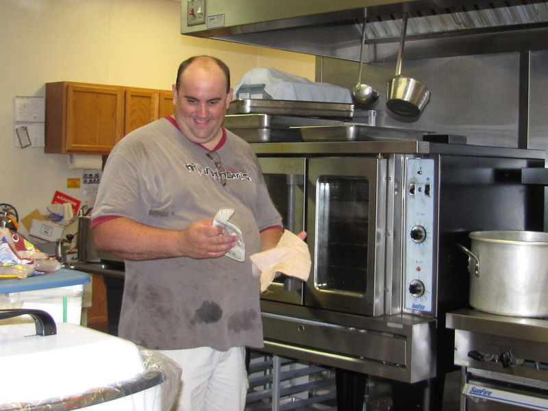 Trent Dalton working hard in the kitchen.