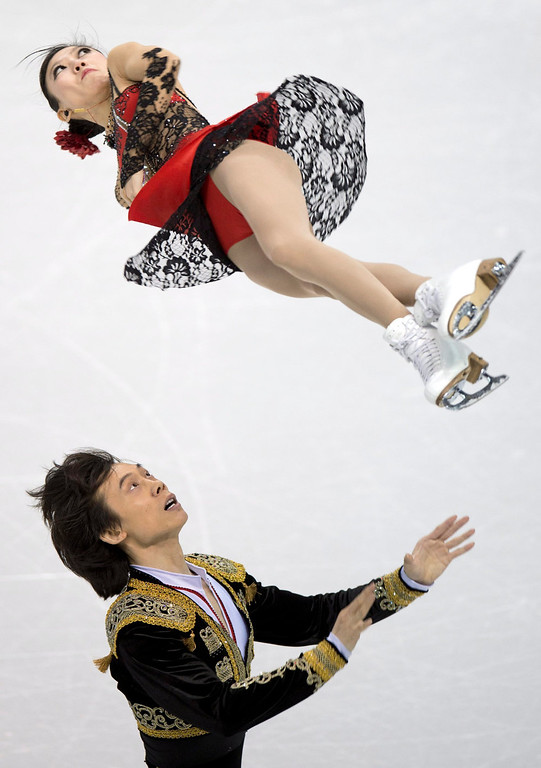 . Qing Pang and Jian Tong of China perform during the pairs short program at the World Figure Skating Championships in London, Ontario, on Wednesday, March 13, 2013. (AP Photo/The Canadian Press, Paul Chiasson)