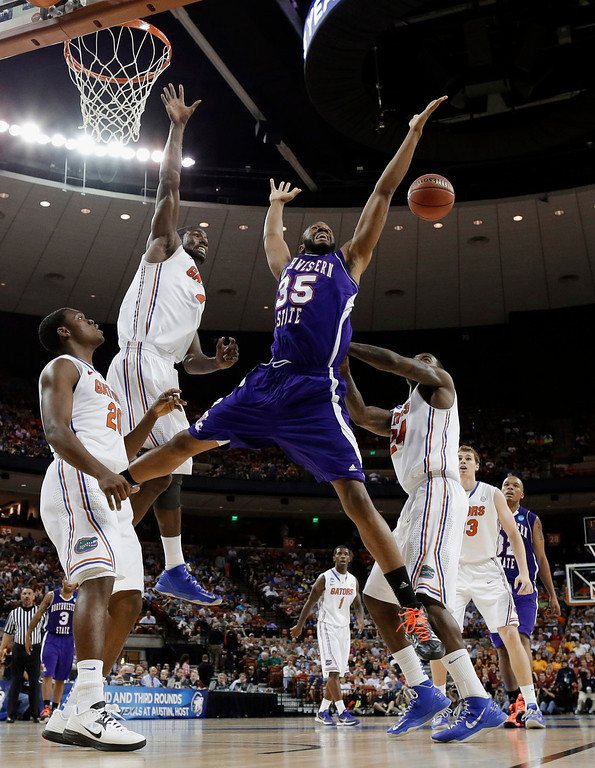 . Northwestern State\'s O.J. Evans (35) loses the ball as Florida\'s Patric Young (4), Michael Frazier II, left, and Casey Prather (24) defend during the second half of a second-round game of the NCAA men\'s college basketball tournament Friday, March 22, 2013, in Austin, Texas. (AP Photo/David J. Phillip)