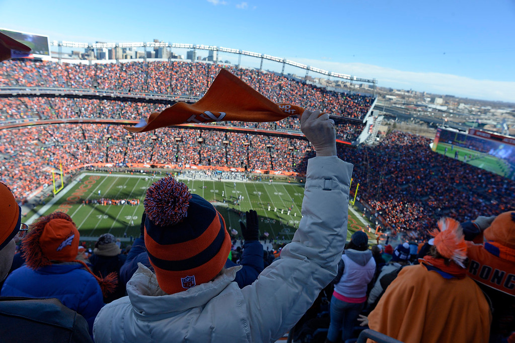 . Broncos fans cheer as the teams take the field before the start of the game. The Denver Broncos take on the San Diego Chargers at Sports Authority Field at Mile High in Denver on January 12, 2014. (Photo by Craig F. Walker/The Denver Post)