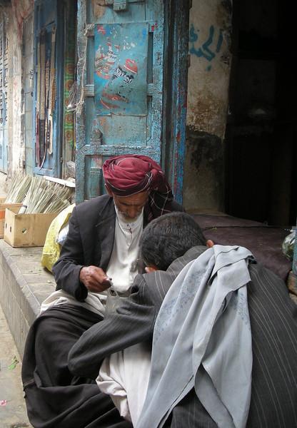 men checking their qat