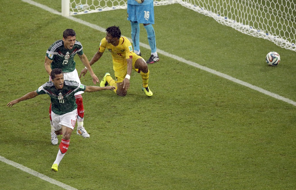. Mexico\'s Giovani dos Santos celebrates before his goal was disallowed by the referee during the group A World Cup soccer match between Mexico and Cameroon in the Arena das Dunas in Natal, Brazil, Friday, June 13, 2014.  (AP Photo/Hassan Ammar)