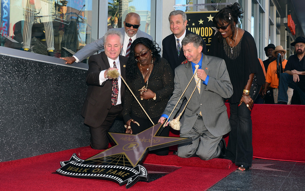 . The late Barry White\'s wife Glodean (C) reacts during the unveiling of her husband\'s posthumous star along the Hollywood Walk of Fame on September 12, 2013. White, who died in 2003 and would have celebrated his birthday September 12, is most well known for his 1970\'s instrumental \'Love\'s Theme\' and is the recipient of the 2,506th Star in the category of recording.         (FREDERIC J. BROWN/AFP/Getty Images)