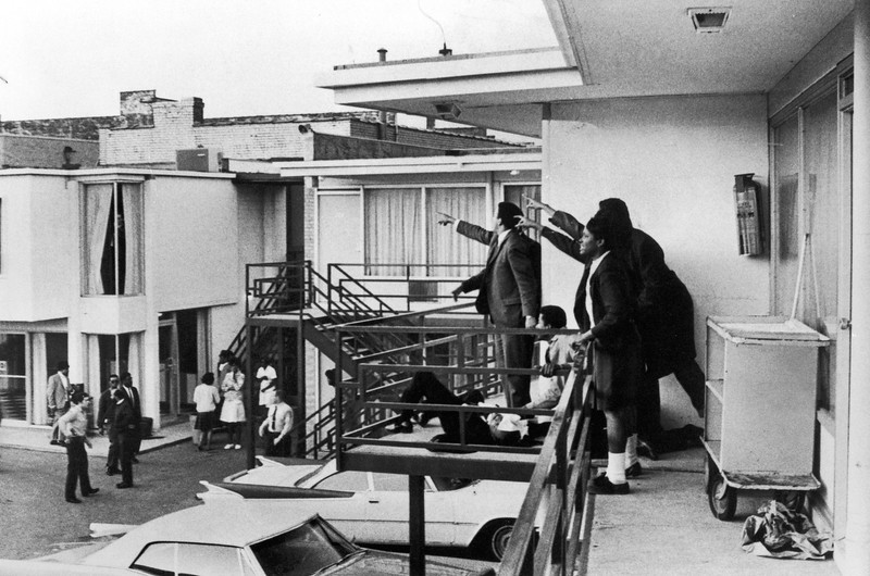 . Civil rights leader Andrew Young (L) and others standing on balcony of Lorraine motel pointing in direction of assailant after assassination of civil rights leader Dr. Martin Luther King, Jr., who is lying at their feet.  (Photo by Joseph Louw/Time & Life Pictures/Getty Images)