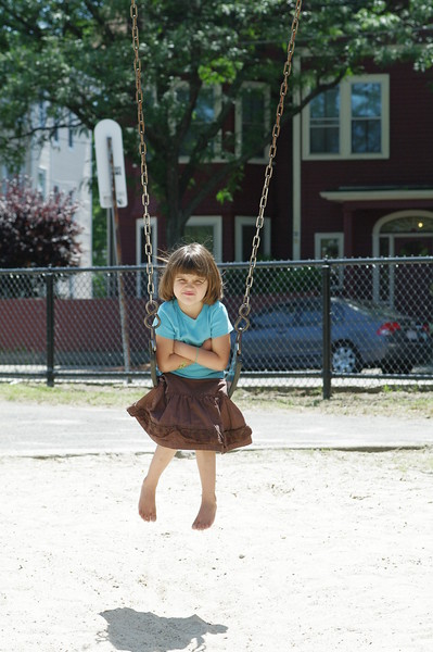 Disgruntled on the swing.