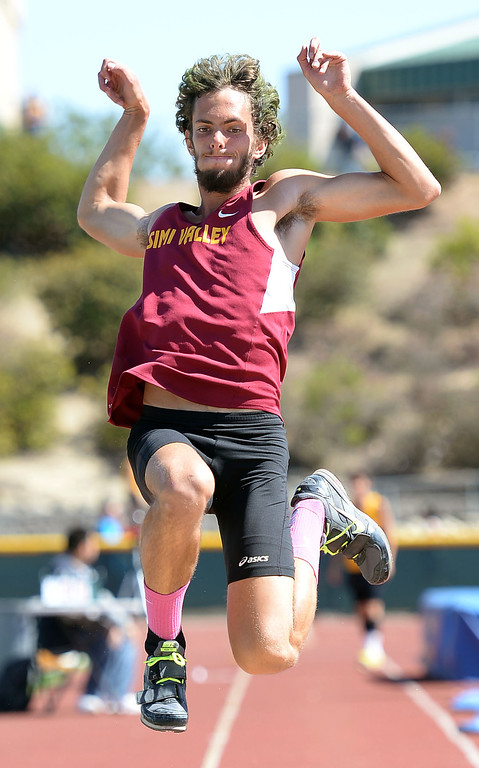 . Simi Valley\'s Alex Billing in long jump action during the Marmonte League track and field finals May 9, 2014 in Moorpark.(Andy Holzman/Los Angeles Daily News)