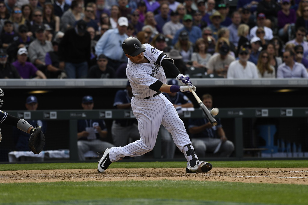 . Trevor Story (27) of the Colorado Rockies hits a home run in the fourth inning. The Colorado Rockies played the San Diego Padres Friday, April 8, 2016 on opening day at Coors Field in Denver, Colorado. (Photo By Andy Cross/The Denver Post)