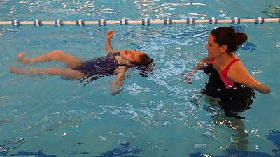 Ella swimming at Issi