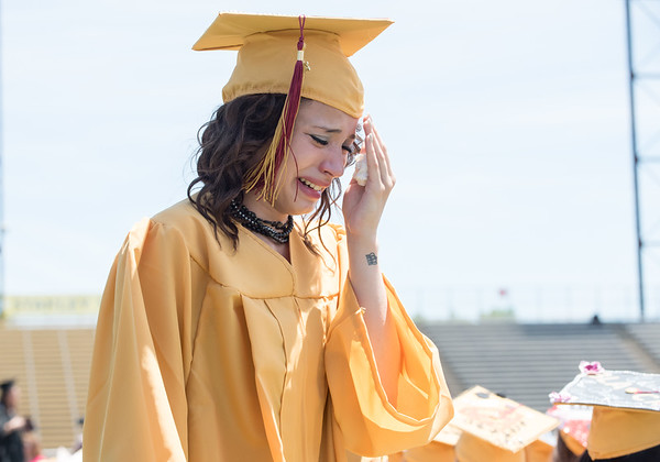 06/19/18 Wesley Bunnell | Staff New Britain High School senior Anahicha Mendez becomes emotional walking down the aisle to her seat after receiving her diploma during graduation exercises at Veterans' Memorial Stadium at Willow Brook Park on Tuesday morning.