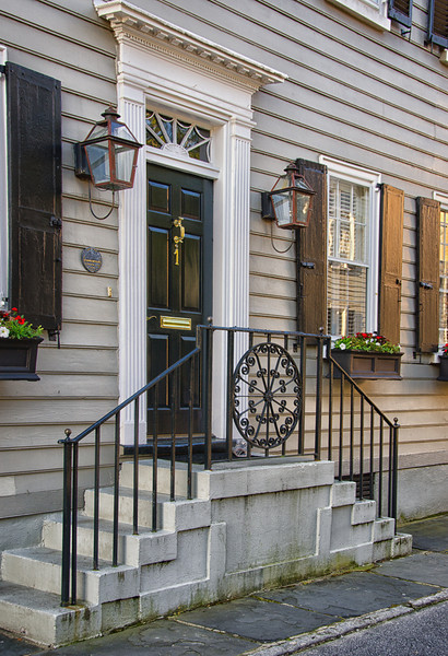 """Even though this building had been remodeled they tried to maintain the """"old"""" look with the shutters and door frame."""