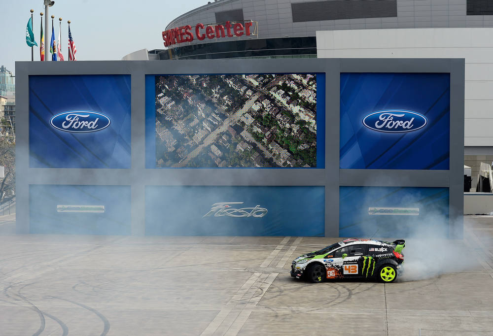. LOS ANGELES, CA - NOVEMBER 28:  Race car driver Ken Block, a professional rally driver with the Monster World Rally Team, drives the Ford three-cylinder Fiesta at the 2012 Los Angeles Auto Auto Show on November 28, 2012 in Los Angeles, California.  The LA Auto Show opens to the public November 30 and runs through December 9.  (Photo by Kevork Djansezian/Getty Images)