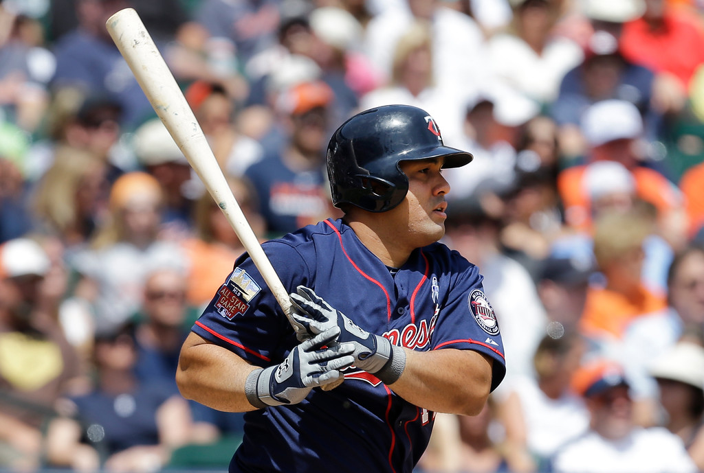 . Minnesota Twins designated hitter Kendrys Morales hits a one-run single against the Detroit Tigers in the sixth inning of a baseball game in Detroit, Sunday, June 15, 2014. (AP Photo/Paul Sancya)