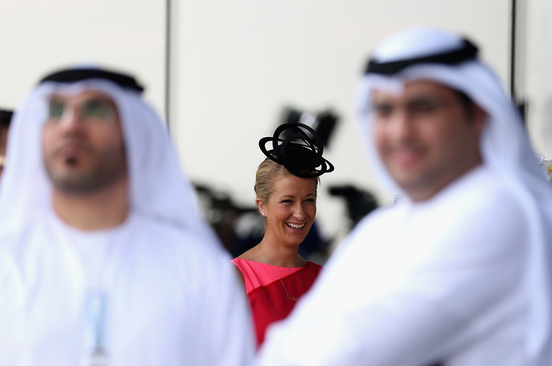 . Race goers are pictured during the Dubai World Cup at the Meydan Racecourse on March 29, 2014 in Dubai, United Arab Emirates.  (Photo by Warren Little/Getty Images)