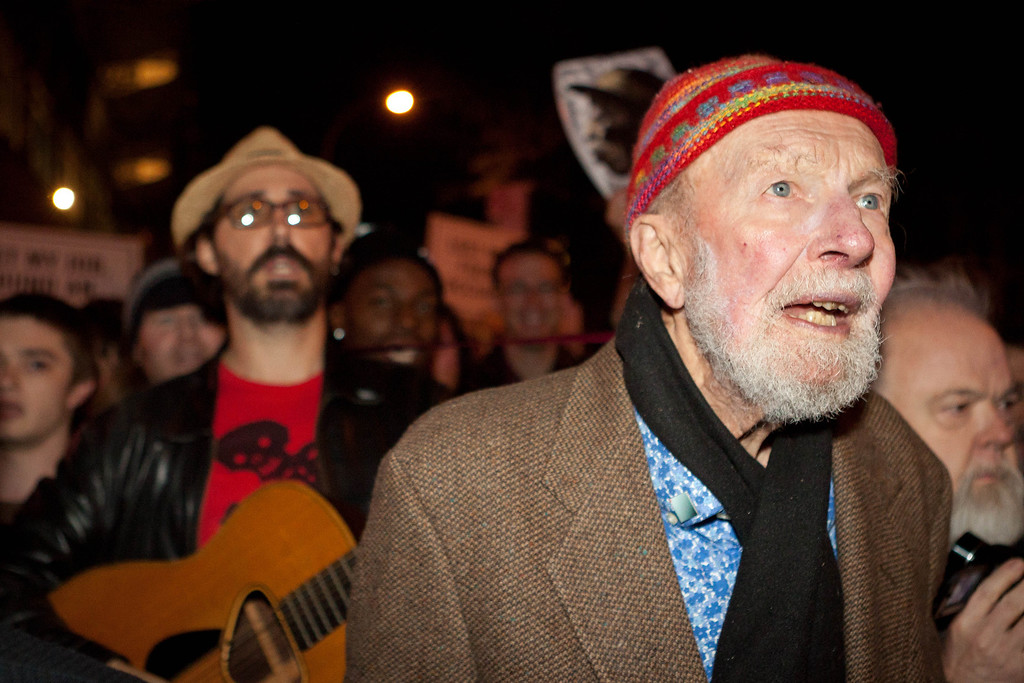 . File-This Oct. 21, 2011, file photo shows activist musician Pete Seeger, 92, left, marches with nearly a thousand demonstrators sympathetic to the Occupy Wall Street protests for a brief acoustic concert in Columbus Circle in New York.    The American troubadour, folk singer and activist Seeger  died Monday Jan. 27, 2014, at age 94.  (AP Photo/John Minchillo, File)