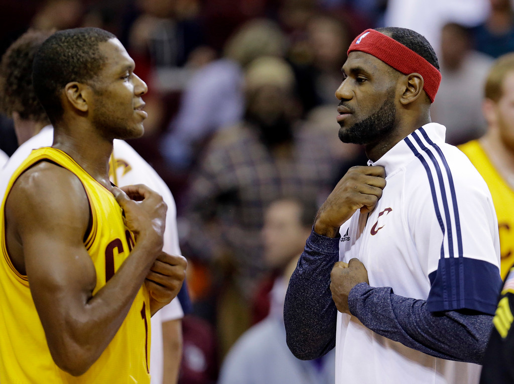 . Cleveland Cavaliers\' James Jones, left, talks with LeBron James during a timeout in the second quarter of an NBA preseason basketball game against the Milwaukee Bucks on Tuesday, Oct. 14, 2014, in Cleveland. (AP Photo/Tony Dejak)