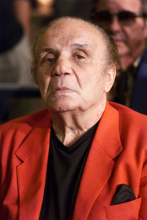 ". Jake LaMotta, ""The Raging Bull,\"" attends boxing matches at Madison Square Garden in New York Saturday, June 19, 1999.  (AP Photo/Mark Lennihan)"