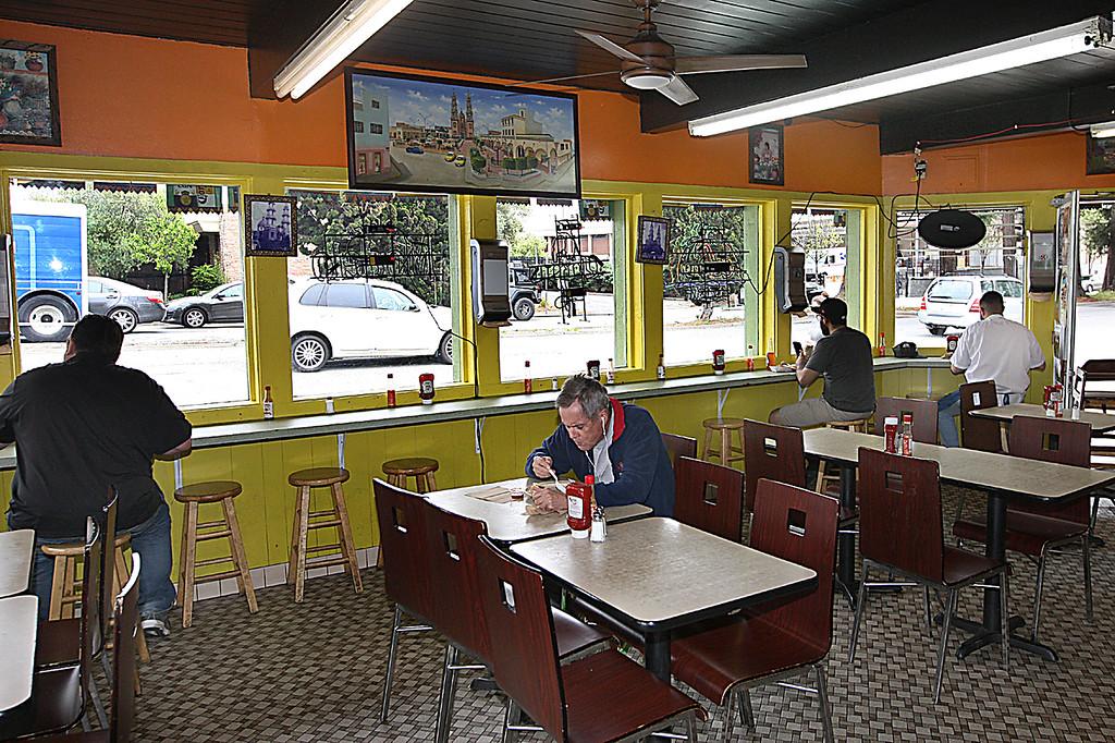 . Late morning diners at Taqueria los Pericos look out onto passing traffic along Water Street. (Dan Coyro -- Santa Cruz Sentinel)