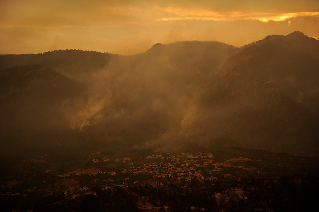 . As the sun sets, the Waldo Canyon Fire continues to grow, Wednesday June 27, 2012, near Colorado Springs. RJ Sangosti, The Denver Post