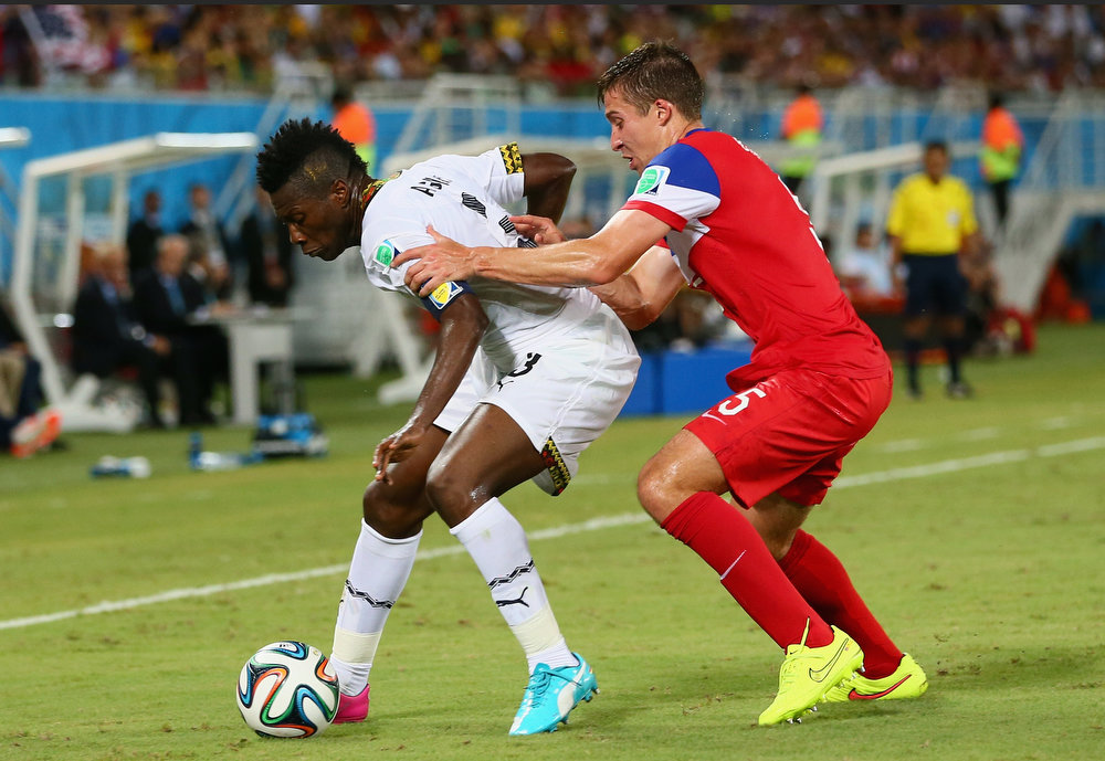 . Asamoah Gyan of Ghana and Matt Besler of the United States battle for the ball during the 2014 FIFA World Cup Brazil Group G match between Ghana and the United States at Estadio das Dunas on June 16, 2014 in Natal, Brazil.  (Photo by Kevin C. Cox/Getty Images)