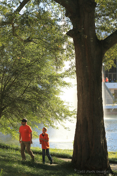 Gameday Father and son by the  Cooper Library reflecting pool.  Clemson University