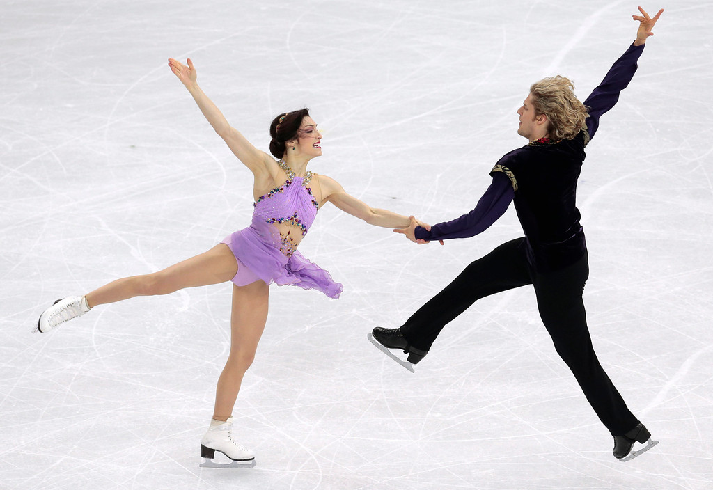 . Meryl Davis and Charlie White of the United States compete in the ice dance free dance figure skating finals at the Iceberg Skating Palace during the 2014 Winter Olympics, Monday, Feb. 17, 2014, in Sochi, Russia. (AP Photo/Ivan Sekretarev)