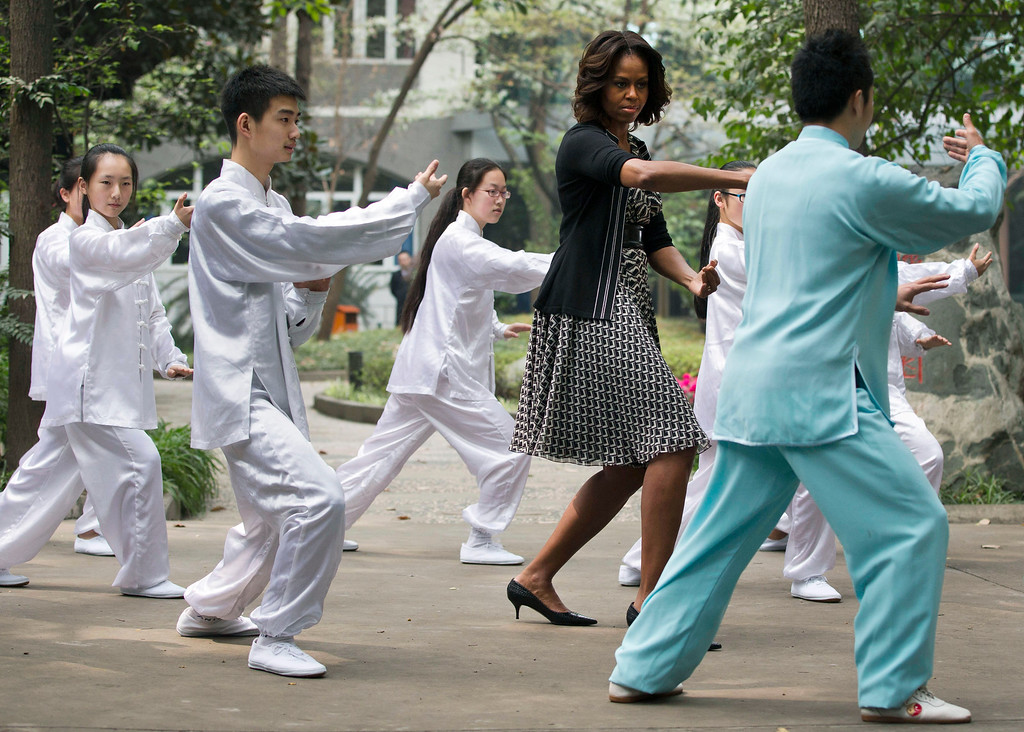 . U.S. first lady Michelle Obama practices tai chi with students at Chengdu No.7 High School in Chengdu in southwest China\'s Sichuan province Tuesday, March 25, 2014. (AP Photo/Andy Wong, File)