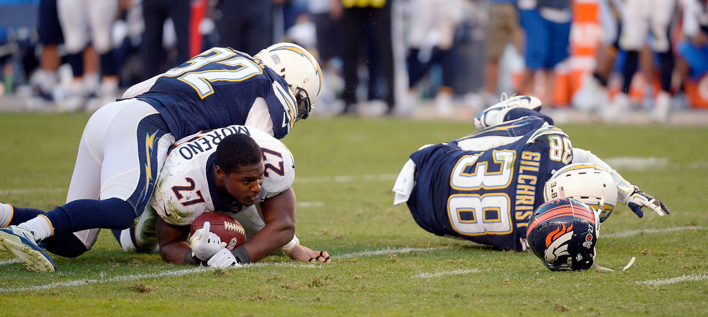 . Denver Broncos running back Knowshon Moreno (27) loses his helmet after getting tackled by San Diego Chargers free safety Eric Weddle (32) during the fourth quarter at Qualcomm Stadium. (Photo by John Leyba/The Denver Post)