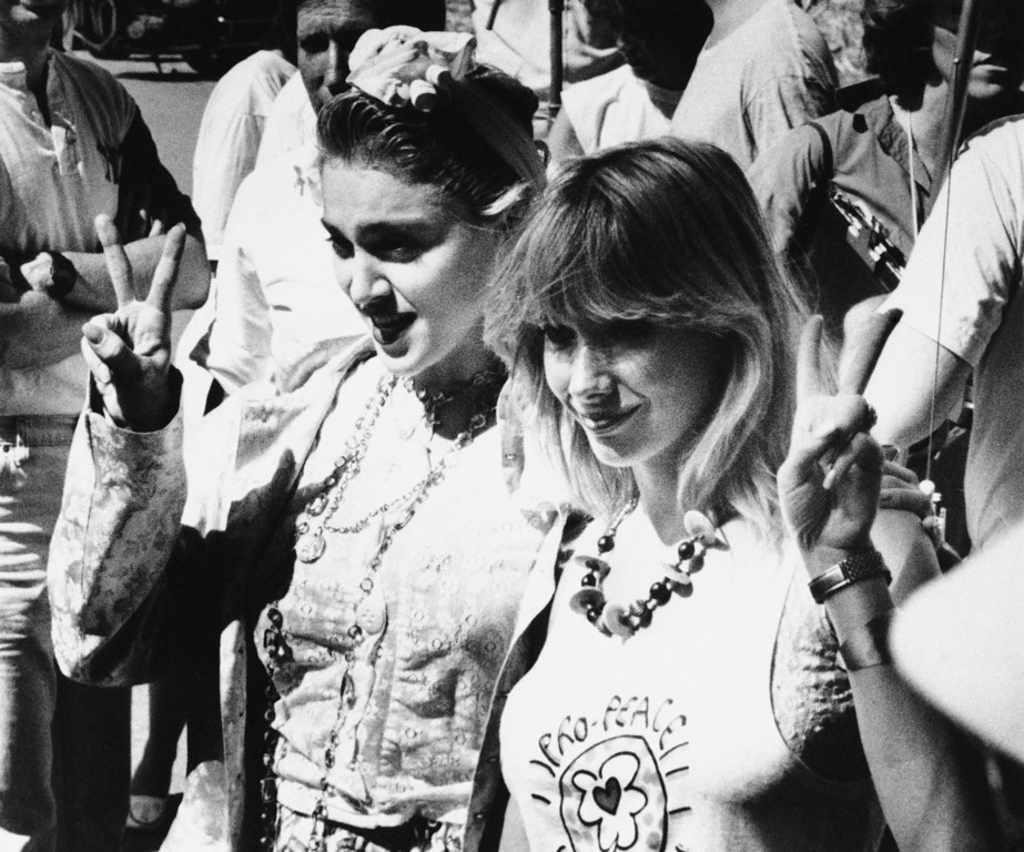 """. Rock star Madonna, left, and Rosanna Arquette make the \""""Peace Sign,\"""" on Saturday, Oct. 5, 1985 in Los Angeles during the taping of a television commercial promoting a cross country peace march. (AP Photo/Jim Ruyman)"""
