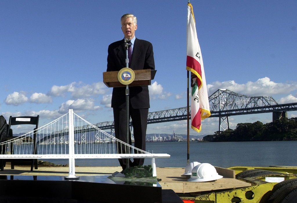 . Governor Gray Davis spoke at  groundbreaking Jan. 29, 2002 for the $2.6 billion Bay Bridge replacement project for the eastern span. A model of the single tower span sits on the stage in the foregound of the 65-year-old cantilever bridge. (Contra Costa Times/Karl Mondon/)