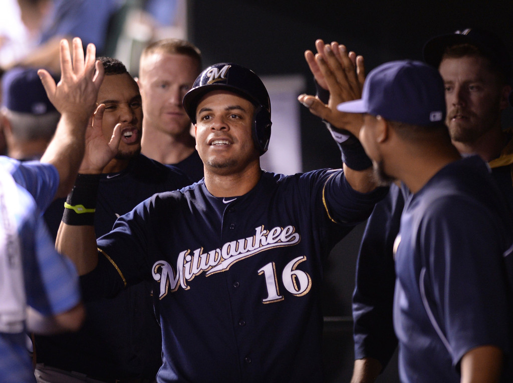 . DENVER, CO - JUNE 20: Milwaukee\'s Aramis Ramirez slapped hands with teammates after he scored on a single by Jean Segura in the sixth inning. The Colorado Rockies hosted the Milwaukee Brewers at Coors Field Friday night, June 20, 2014. Photo by Karl Gehring/The Denver Post