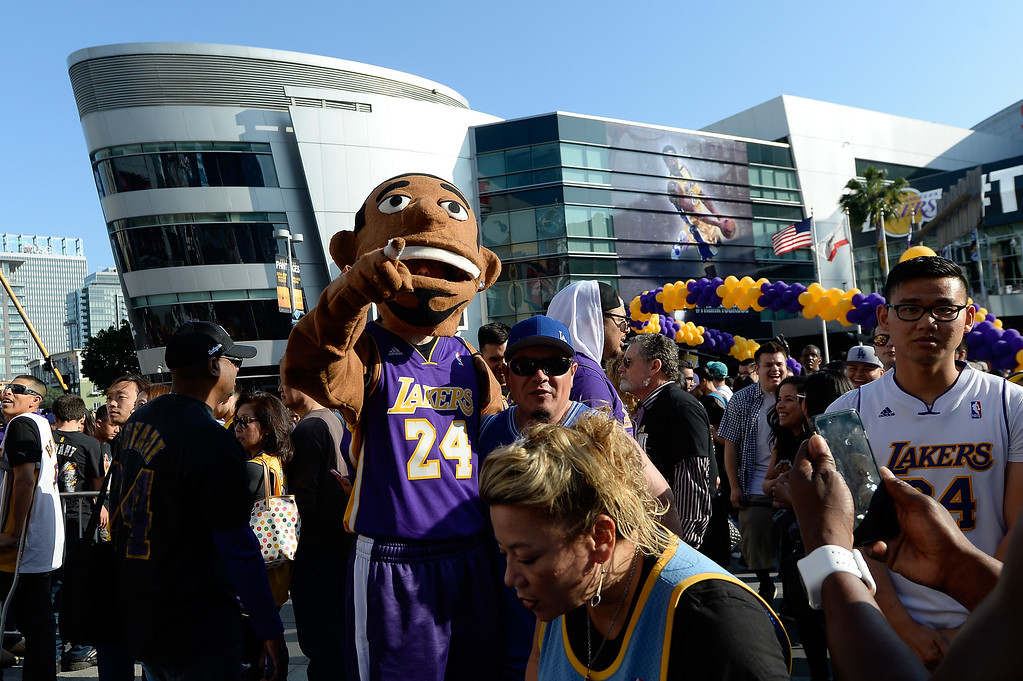 . LOS ANGELES, CA - APRIL 13:  A Kobe Bryant costume is seen as fans gather outside Staples Center before the Los Angeles Lakers take on the Utah Jazz in which Kobe Bryant will play his final game on April 13, 2016 in Los Angeles, California. NOTE TO USER: User expressly acknowledges and agrees that, by downloading and or using this photograph, User is consenting to the terms and conditions of the Getty Images License Agreement.  (Photo by Kevork Djansezian/Getty Images)