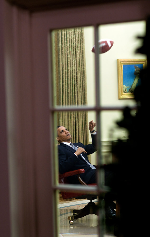 . April 23, 2009 �The President throws a football to one of his aides before a meeting in the Oval Office.� (Official White House photo by Pete Souza)