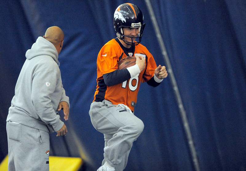 . Denver Broncos quarterback Peyton Manning (18) runs through drills during practice under the bubble Wednesday, December 19, 2012 at Dove Valley as they prepare for the Cleveland Browns.  John Leyba, The Denver Post