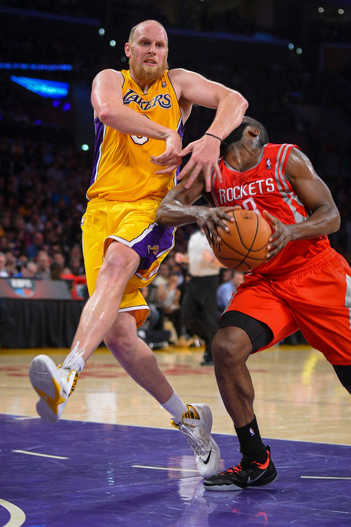 . Lakers� Chris Kaman fouls rockets� James Harden during first half action at Staples Center Wednesday, February 19, 2014. ( Photo by David Crane/Los Angeles Daily News )