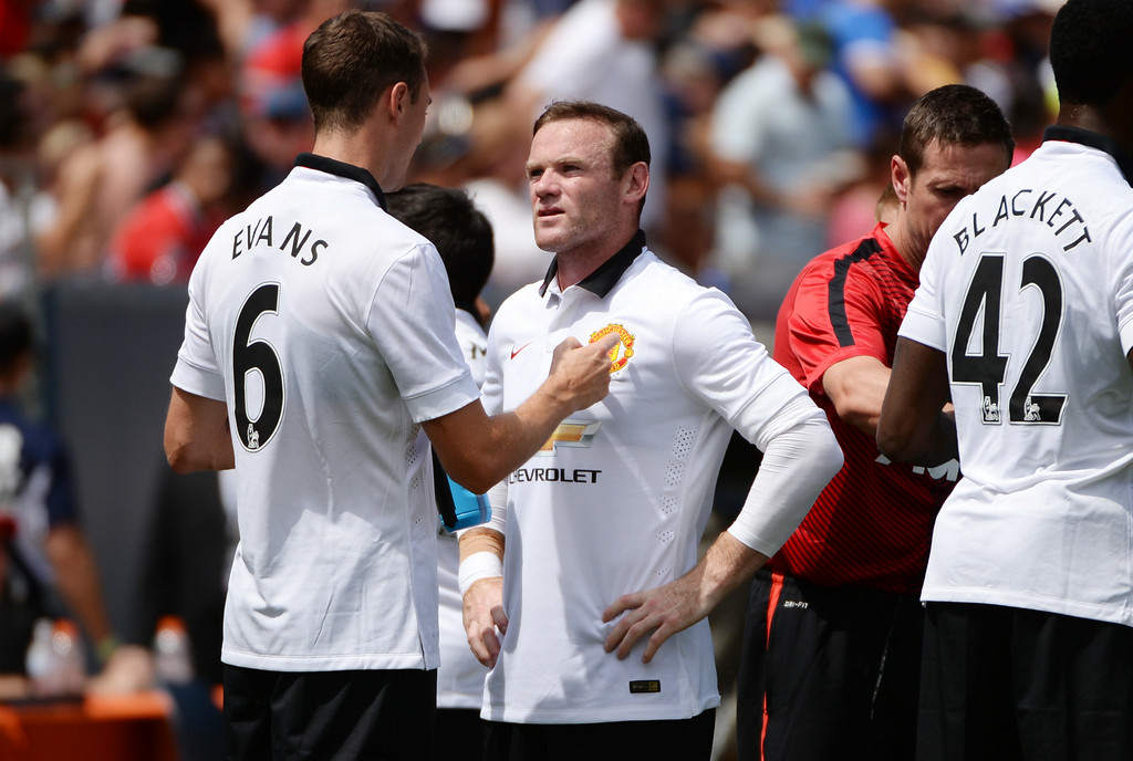 . Jonny Evans of Manchester United (6) is talking to his teammate Wayne Rooney (10) during the game against AS Roma at Sports Authority Field at Mile High in Denver, Colorado, July 26, 2014. (Photo by Hyoung Chang/The Denver Post)