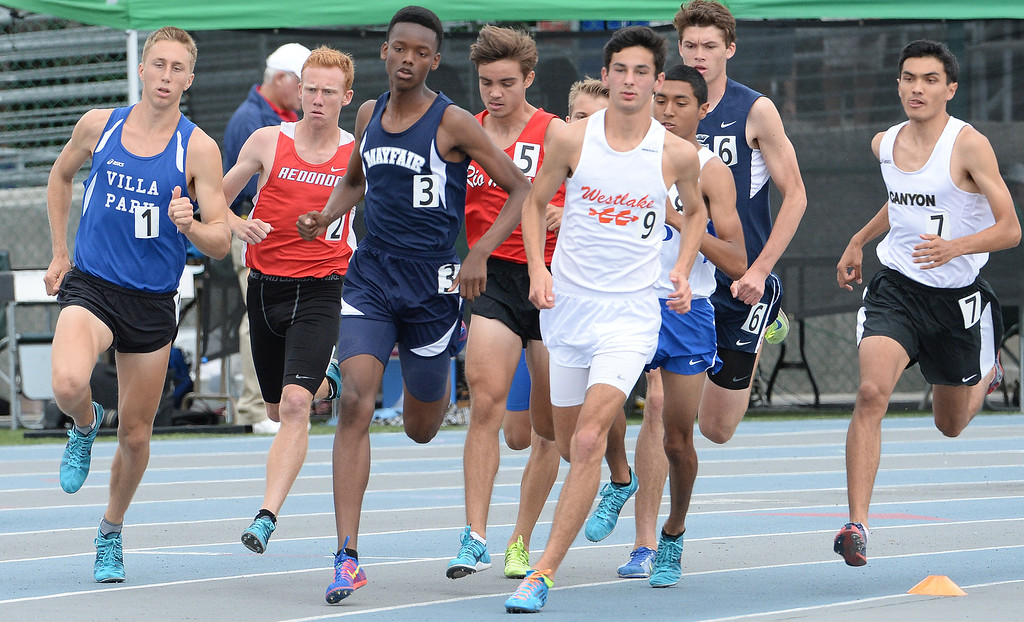 . Mayfair\'s Ellis Newton competes in the division 2 1600 meter run during the CIF Southern Section track and final Championships at Cerritos College in Norwalk, Calif., Saturday, May 24, 2014.   (Keith Birmingham/Pasadena Star-News)