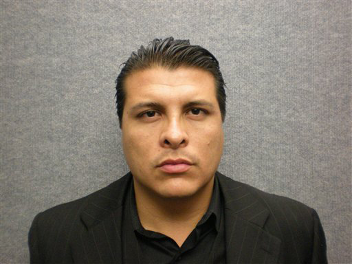 . This photo provided by the Orange Police Department shows the undated booking photo for Shazer Fernando Limas, 31, who was arrested early Friday May 4, 2012 following the chase on Interstate 5. He is suspected of killing his girlfriend, Arlet Hernandez Contreras, 31, and the couple\'s two young boys. (AP Photo/Orange Police Department)