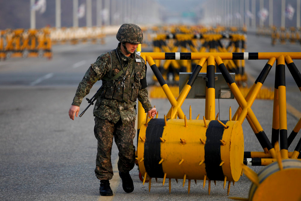 . A South Korean soldier sets up a barricade at a checkpoint on the Grand Unification Bridge, which leads to the demilitarized zone separating North Korea from South Korea, in Paju, north of Seoul April 8, 2013. The North, led by 30-year-old Kim Jong-un, has been issuing vitriolic threats of war against the United States and U.S.-backed South Korea since the United Nations imposed sanctions in response to its third nuclear weapon test in February.     REUTERS/Kim Hong-Ji