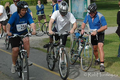 2009 Ottawa Riverkeeper Triathlon. Cyclists mounting their bicycles after the transition stage between swimming and cycling.  © Rob Huntley