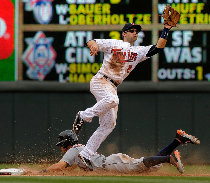 . Minnesota Twins second baseman Brian Dozier (2) takes a high throw as Detroit Tigers� Ian Kinsler steals the base during the sixth inning of a baseball game in Minneapolis, Sunday, Aug. 24, 2014. Detroit won 13-4.(AP Photo/Tom Olmscheid)
